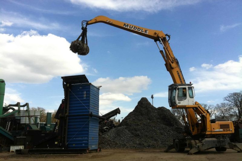 Ferrous scrap shredded loaded into containers